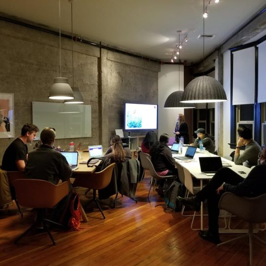 group of people working inside the office